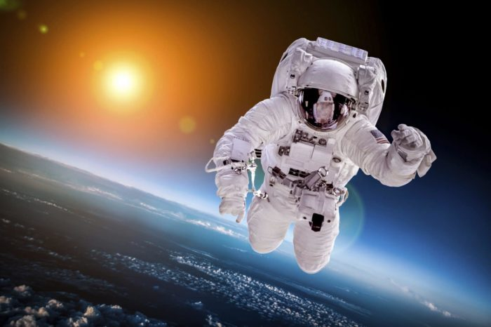 Astronaut in outer space against the backdrop of the planet earth. Elements of this image furnished by NASA.